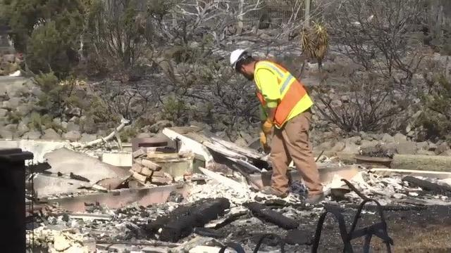 Residents Return to Homes Spared from Wildfires