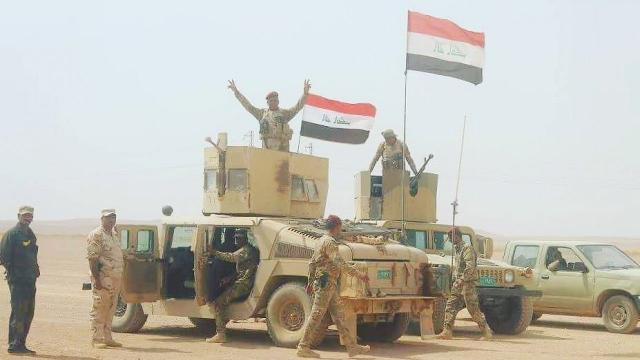 Kurds lose Kirkuk as Iraqi forces take back oil fields, air base