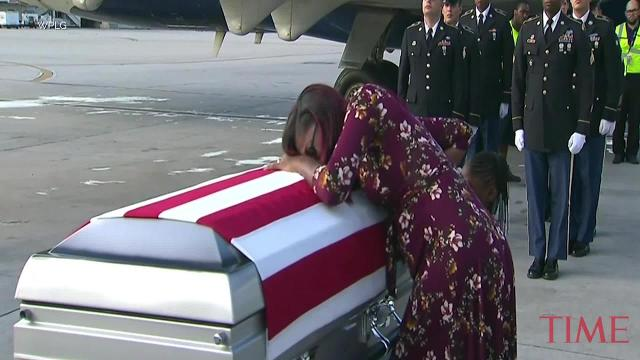 Widow of slain U.S. soldier greets his coffin in Miami