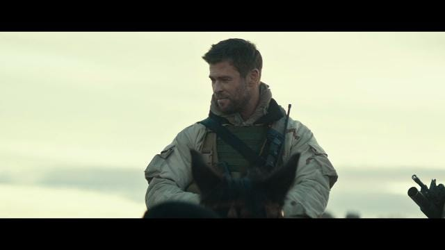 Chris Hemsworth leads a band of soldiers in '12 Strong'
