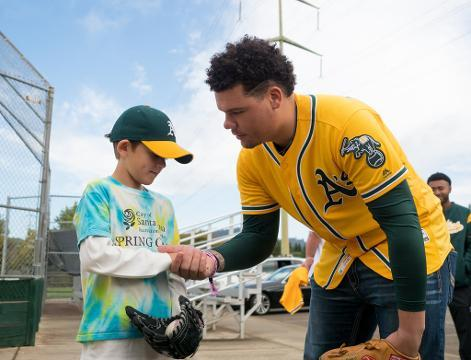 A's replenish young boy's memorabilia collection after losing it in a fire