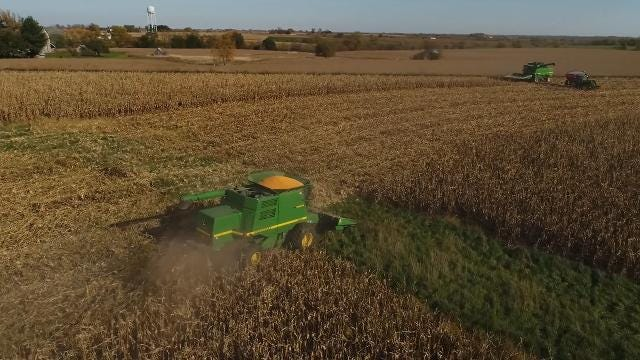 Neighbors pull together to harvest farmer's last crop