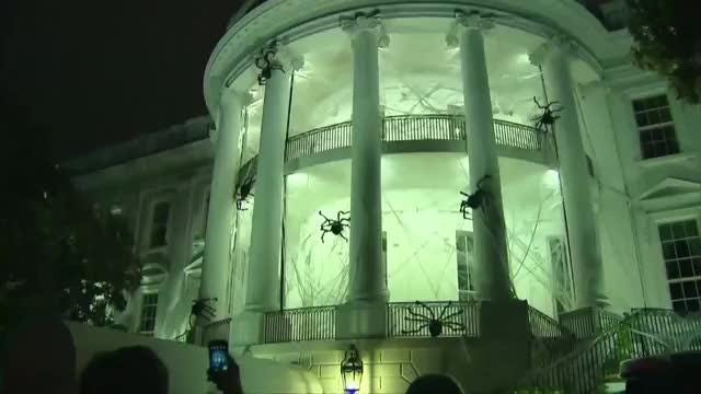 Giant spider webs adorn White House for Halloween