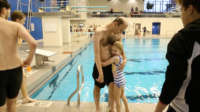 This little girl cheering on her father just stole our hearts