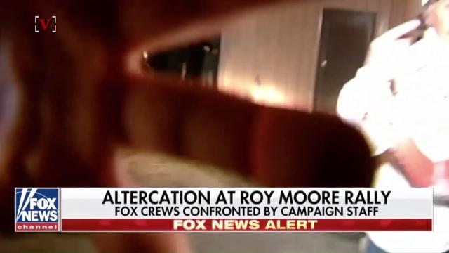 Moore campaign coordinator confronts cameraman at candidate's event