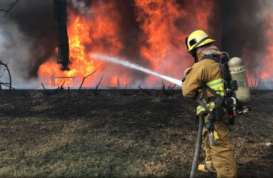 Firefighters battle flames just feet from LA homes