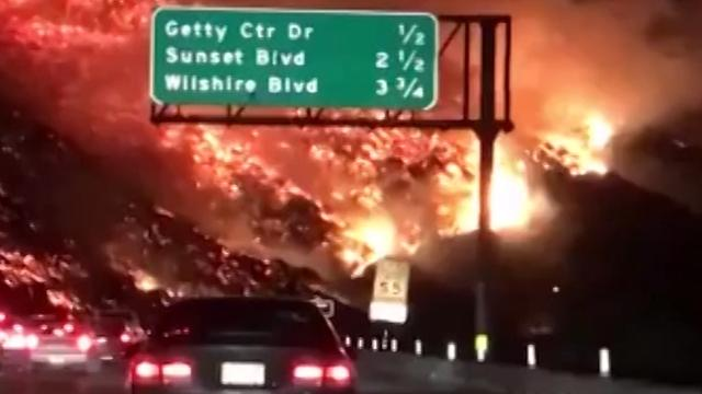 Dramatic L A  wildfire video looks like driving into hell