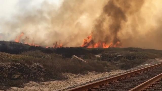 Raw: Calif. wildfire forces evacuations along coast