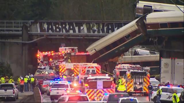 Amtrak train derails, hangs over interstate