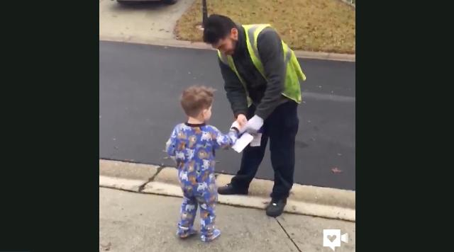 Boy hands out Christmas cheer to sanitation workers