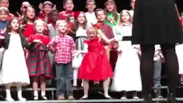 This little lady taught everyone a thing or two about Christmas spirit when she busted out her dance moves.