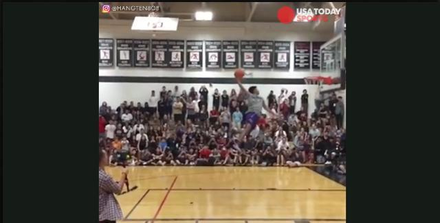 Kid makes crazy dunk in front of classmates