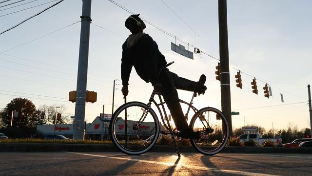 "The ""Bike Guy"" brings smiles to commuters stuck in traffic"