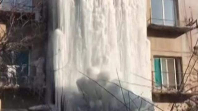 Leaking pipe creates incredible frozen waterfall