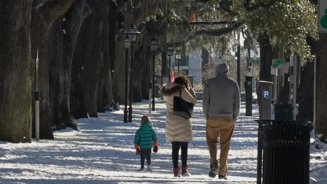 South revels in rare snow as north gets hit hard