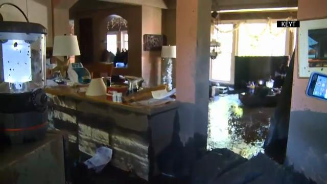 Man returns to mudslide damaged home