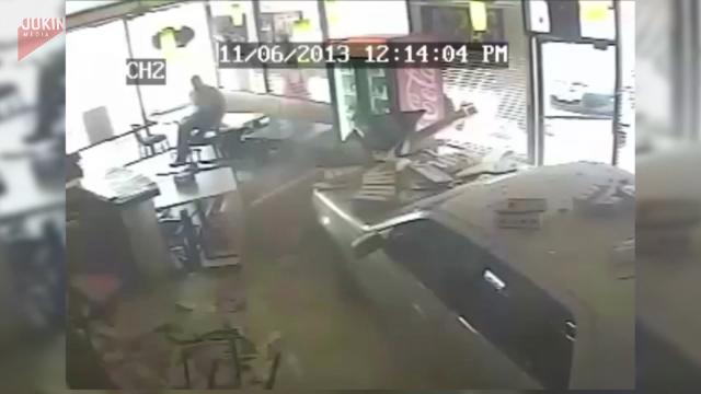 Car crashes into pizzeria, barely misses a customer