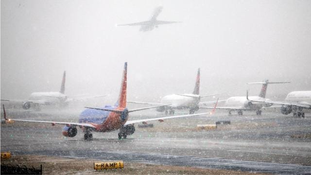 Hundreds of flights delayed, canceled because of Atlanta snow