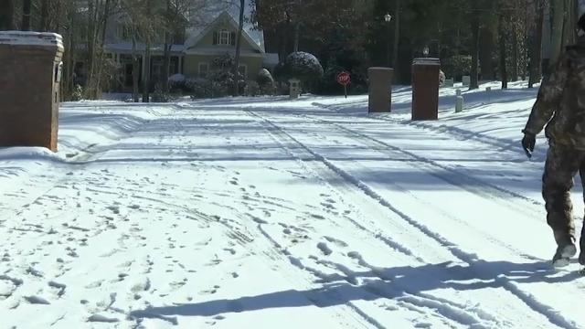 Frigid air brings snow and ice to the South