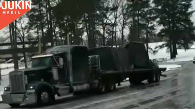When a sports car made it up this icy hill without problem, this semi truck driver may have thought it would be easy.