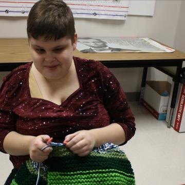 Blind student knits during class to help charity