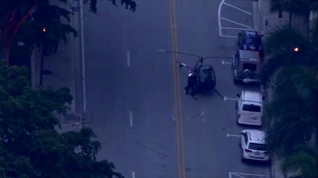 Raw: Helicopter hard landing on Florida street
