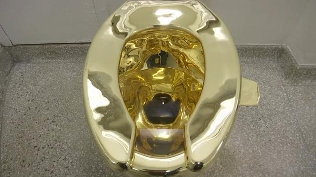gold toilet.  Museum offers used gold toilet to Trumps