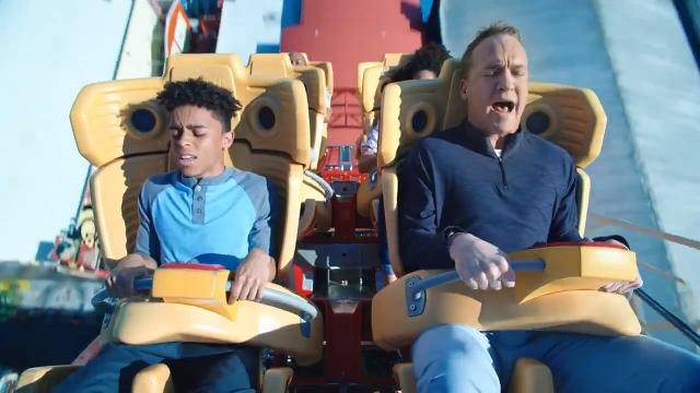 Former NFL quarterback Peyton Manning can't quite get out of football mode while visiting Universal Orlando.