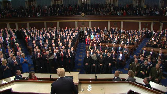 Minority lawmakers hear division in Trump speech