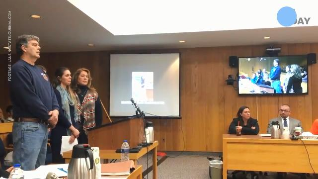 Victims' father rushes Larry Nassar in court