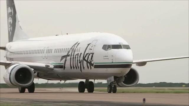 An Alaska Airlines flight from Anchorage to Seattle had to turn back around after a passenger locked himself in the bathroom and took off all his clothing.