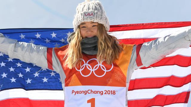 She's 17 years old and already snagged a gold medal for her feat over the halfpipe, but it's her dad's homemade sign and their heartwarming relationship that's captivating America.