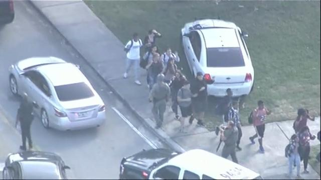 Students flee Florida high school after shooting