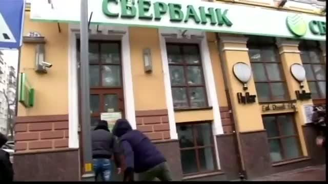Dozens of activists have vandalised Russian banks and a federal agency in Kiev, hurling stones and bottles. Rough Cut (No Reporter Narration) Video provided by Reuters