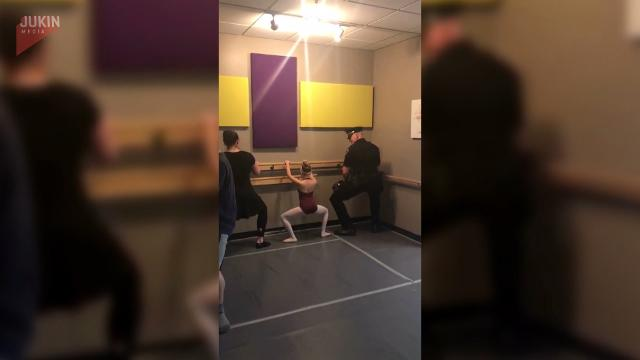 Police officer takes ballet class with daughter