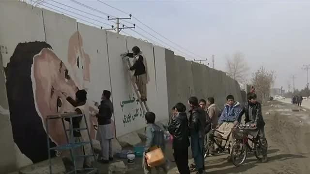 Activists in Afghanistan's capital are painting murals on concrete blast walls as a tool for social change. Rough cut (no reporter narration). Video provided by Reuters
