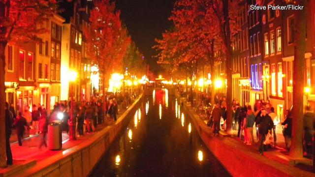 Tourists in Amsterdam will soon have to turn their backs on sex workers in the city's iconic Red Light District.