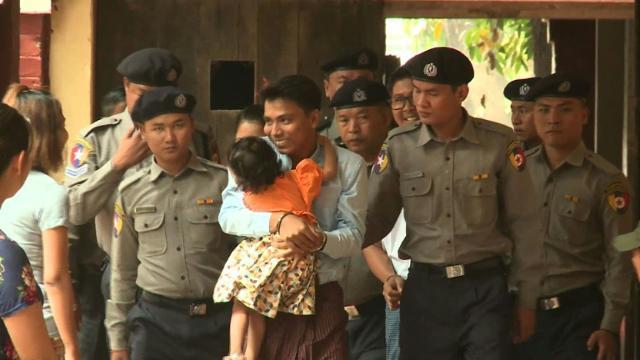 Detained Reuters journalists arrive in Myanmar court.