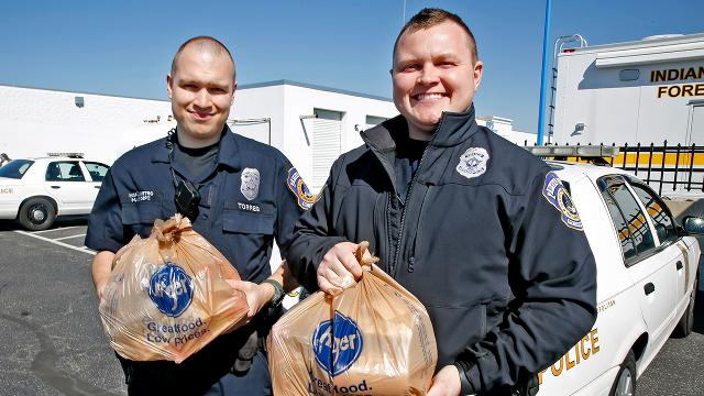 Police pass out emergency food bags while on patrol