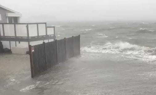 Winds and rains are tearing up the Atlantic coast with a brutal storm surge.