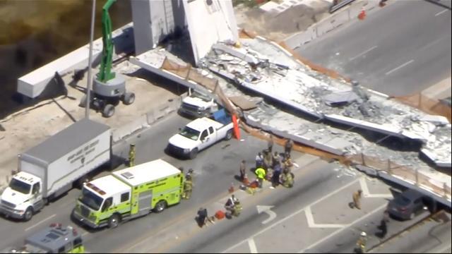 Miami pedestrian bridge collapses, killing six people, crushing cars