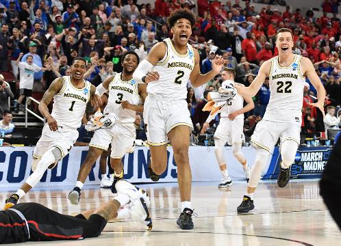 SportsPulse: Upsets and buzzer-beaters close out the first day of the second round of the NCAA tournament.