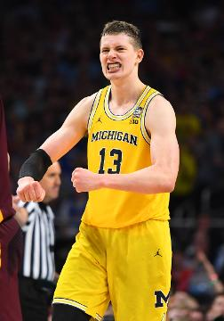 Moe Wagner joined Hakeem Olajuwon and Larry Bird as the only players to have at least 20 points and 15 rebounds in a national semifinal as Michigan beat Loyola Chicago.