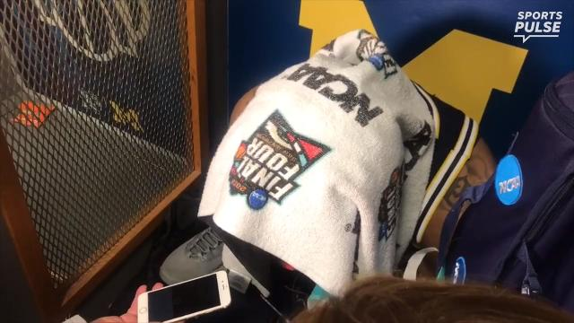 SportsPulse: Many tears were shed in the Michigan locker room after their loss to Villanova. One theme was clear, players were quick to express their love for their teammates.