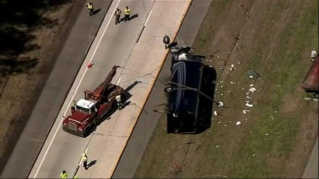 A tour bus headed to the Masters golf tournament flipped over on a Georgia interstate Thursday, injuring at least a dozen people and snarling traffic. The bus driver has been charged with DUI. (April 5)