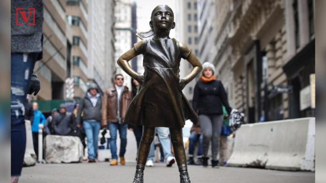 Fearless girl  getting a new home on Wall Street in front of New York  Stock Exchange 522c9a412e20b