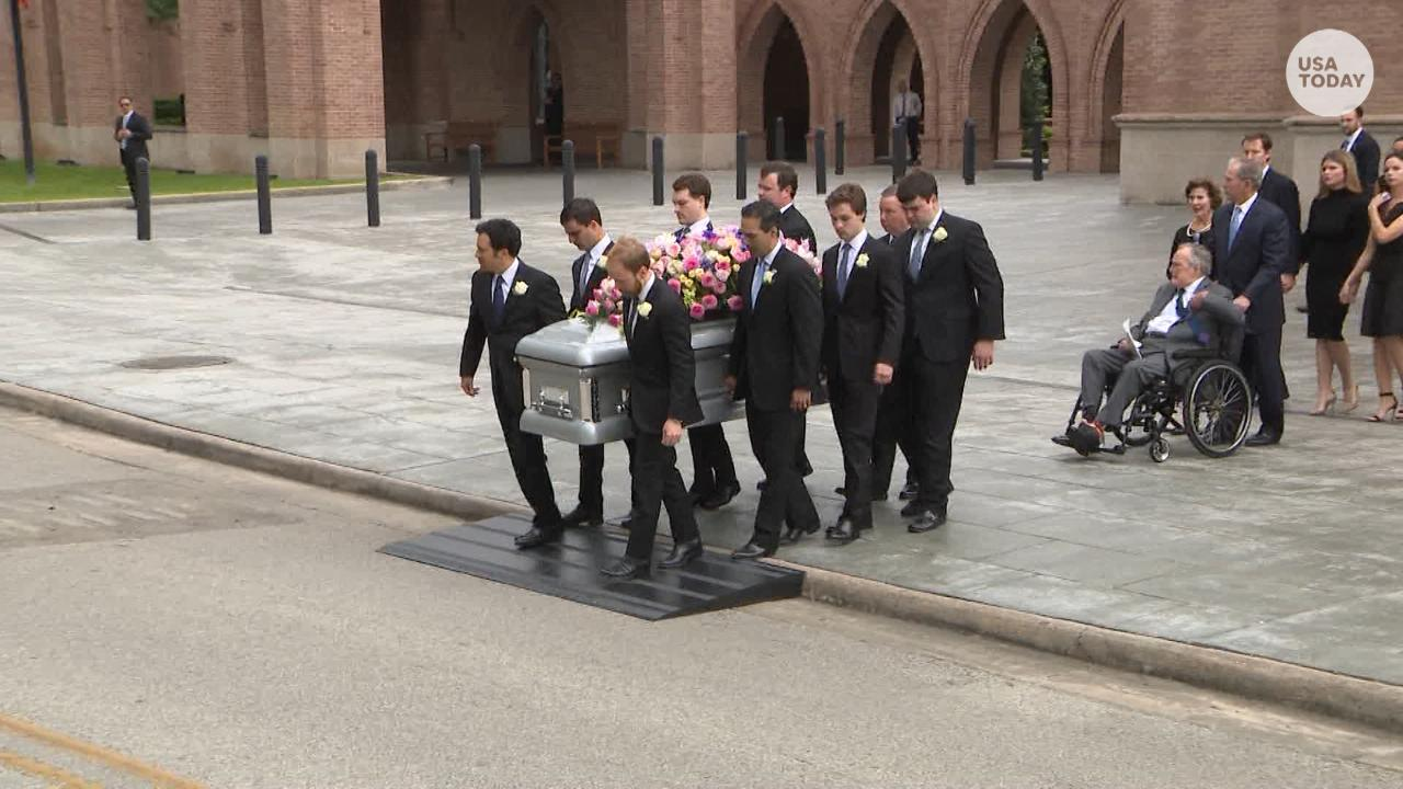 The remains of first lady Barbara Bush were carried  by her grandsons outside St. Martin's Episcopal Church in Houston.