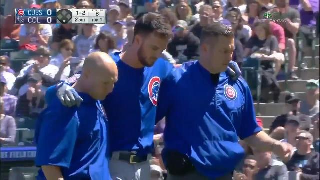 Chicago Cubs third baseman Kris Bryant left Sunday's game against the Colorado Rockies after being hit in the head by a pitch.