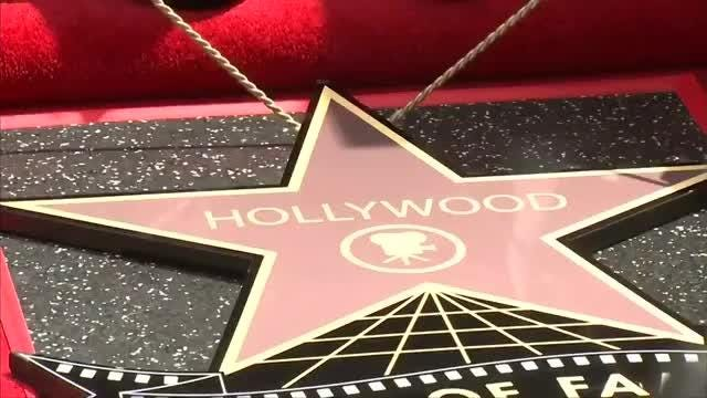 Years after going on a hiatus, boyband NSYNC reunite to be awarded a star on Hollywood's Walk of Fame.