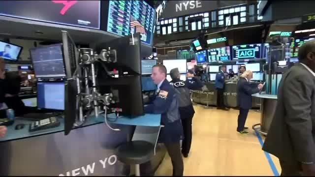 Wall Street rises as Apple rallies
